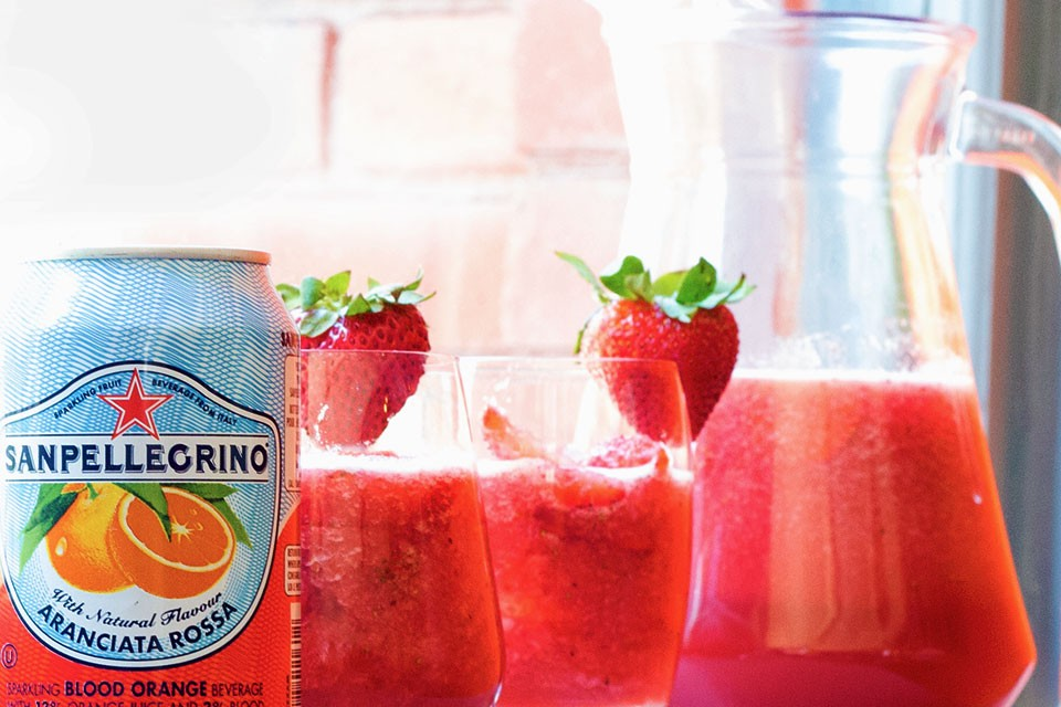 Rossini drink recipe. This combo of grape juice, strawberry purree and SAN PELLEGRINO ARANCIATA celebrates the colours of Canada.