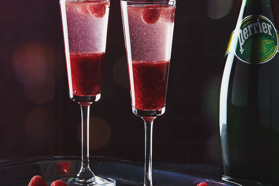 PERRIER Royal Raspberry drink recipe. The extraordinary cocktail combines vodka, respberry purée and PERRIER.